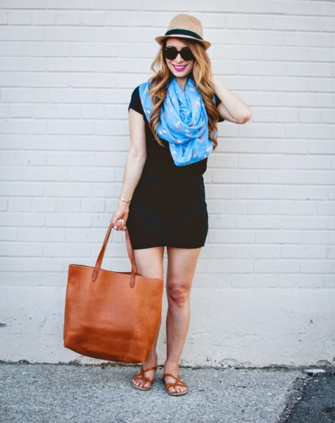 With black mini dress, blue scarf, hat and brown sandals