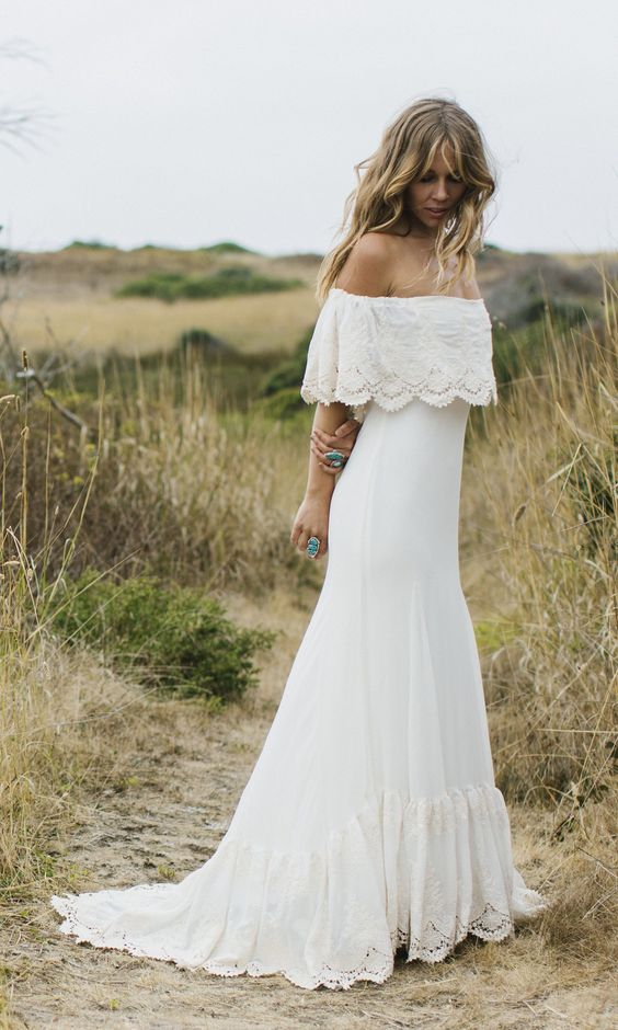 a boho lace fitting off the shoulder wedding dress with a small train is ideal for a summer bride