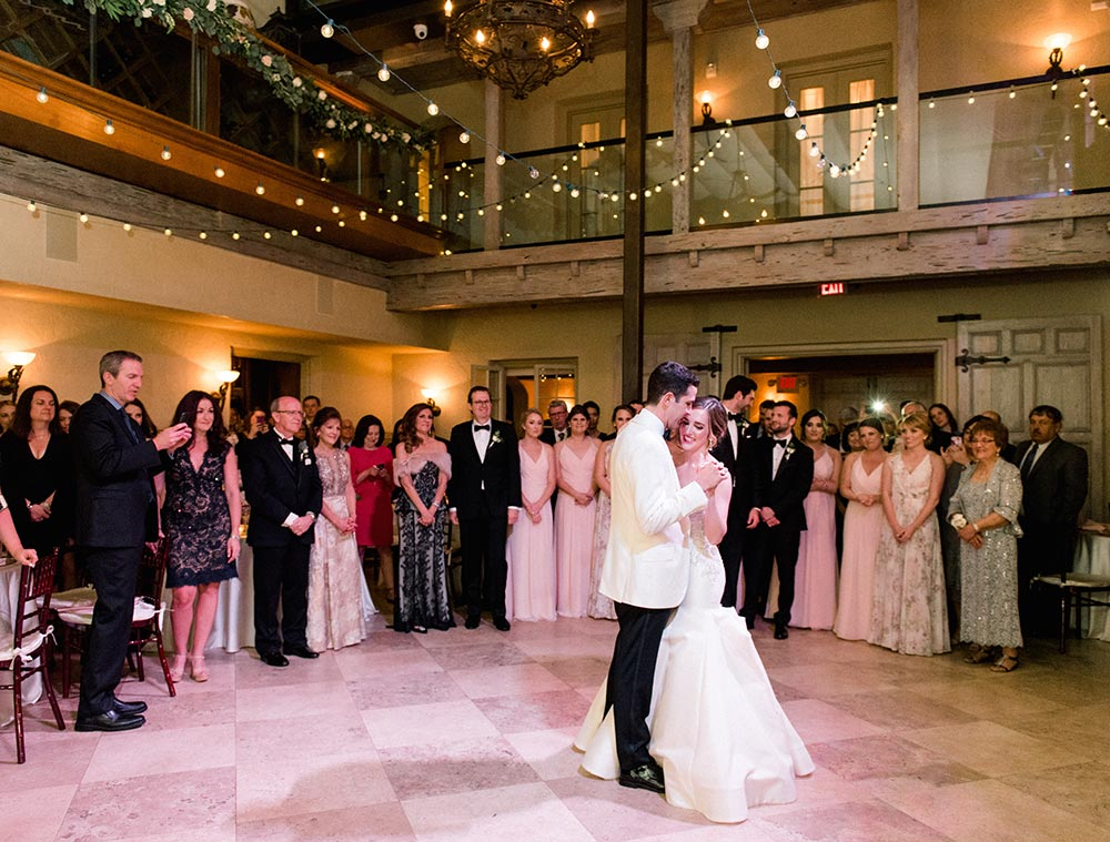 strapless embellished wedding dress and white groom tux wedding first dance