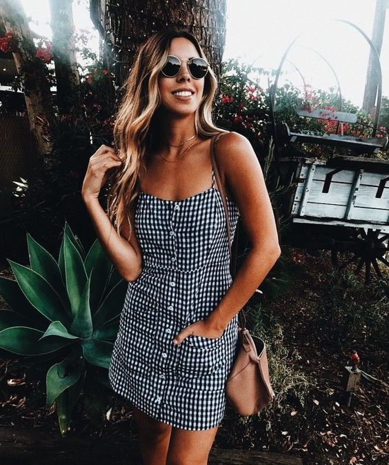 a short gingham button down dress, a tan bag for a simple yet sexy look