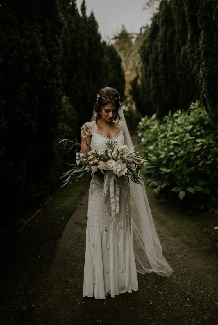 The bride was wearing a beautiful embellished dress with draped cap sleeves in 1920s style