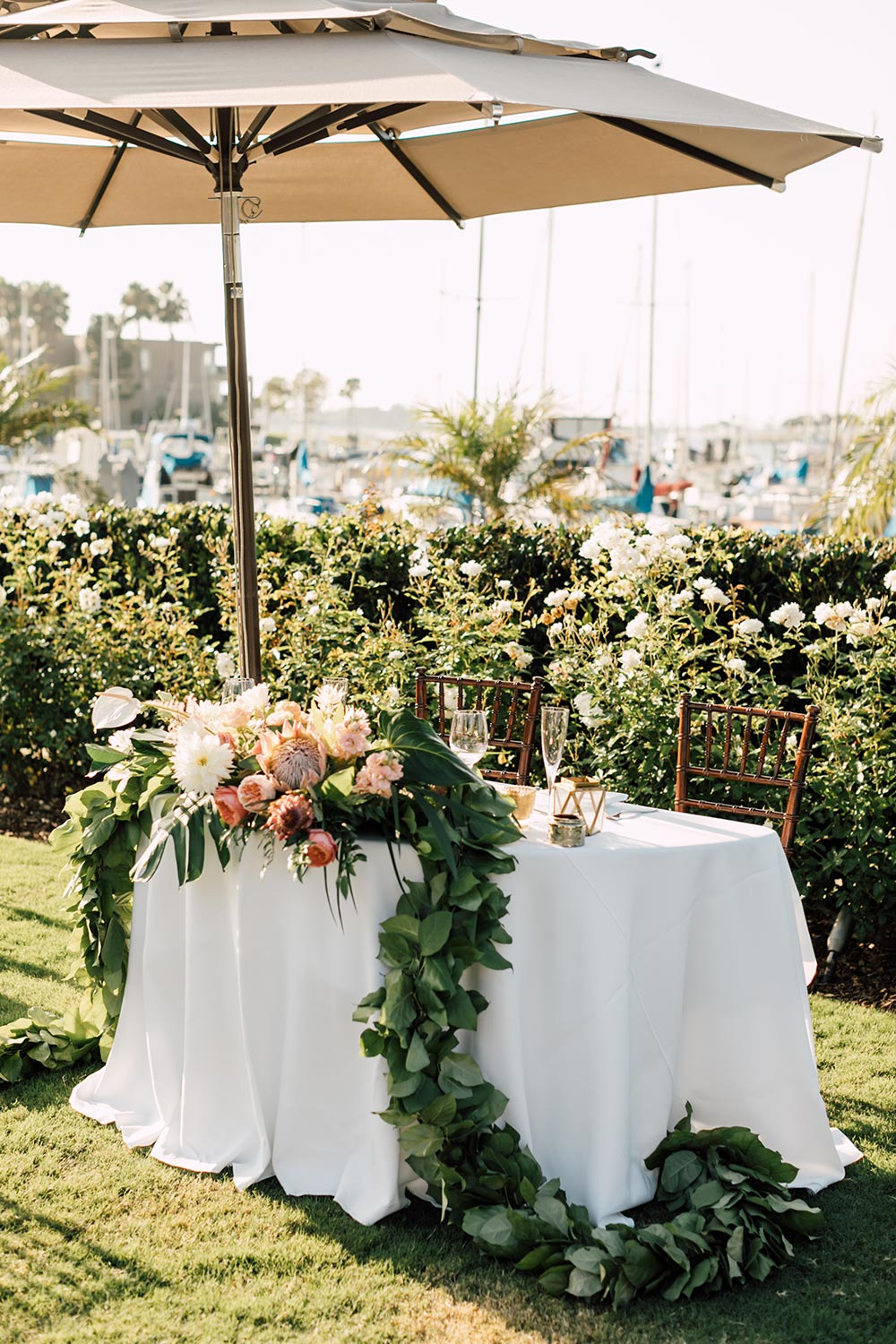 tropical flower garland wedding sweetheart table