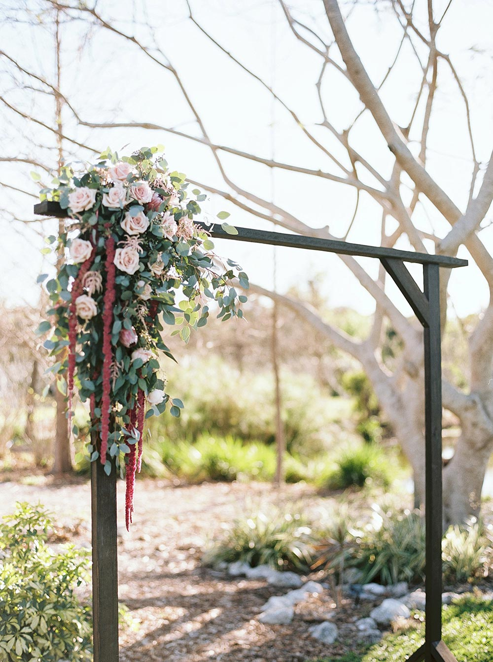 wedding ceremony arbor with flowers