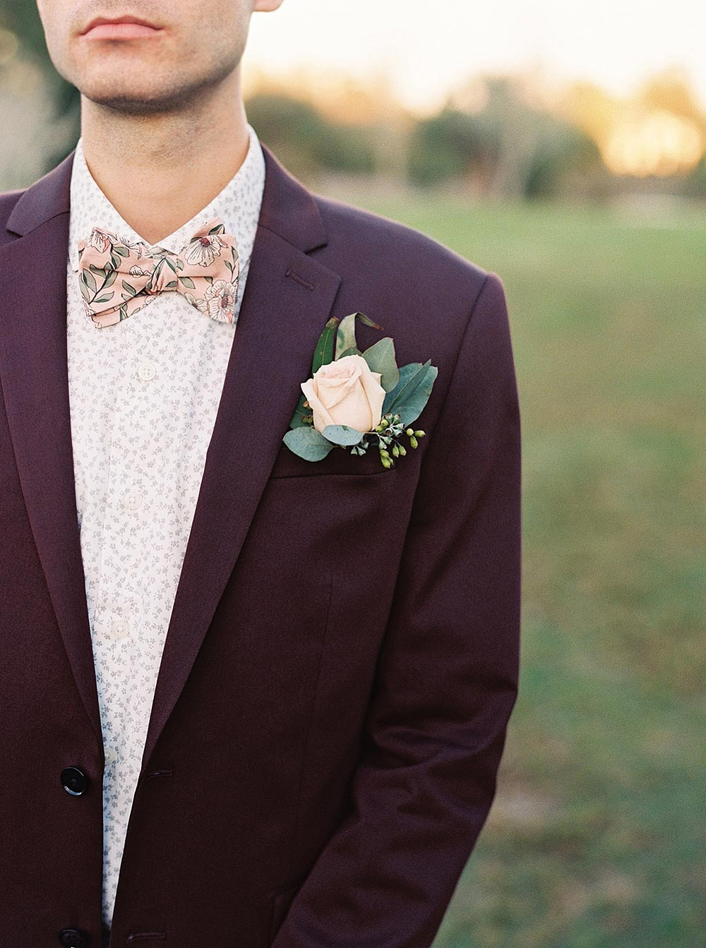 maroon groom suit with floral bow tie