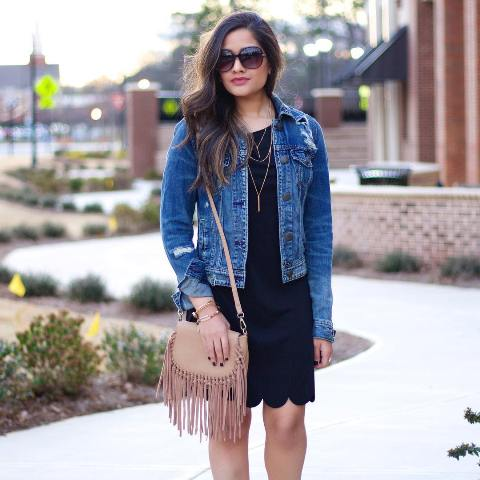 With black dress and fringe bag