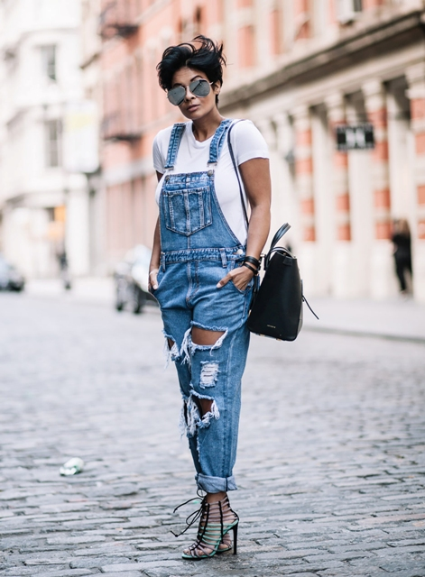 With white t-shirt, lace up sandals and backpack
