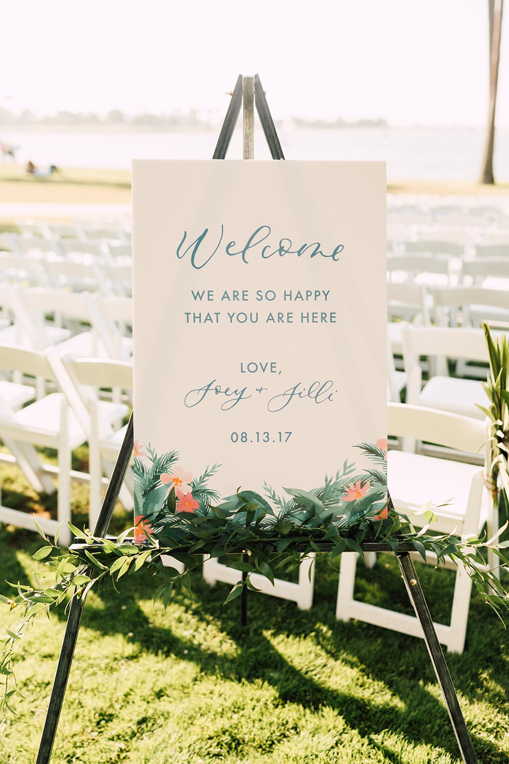 tropical wedding signage with brushstroke calligraphy