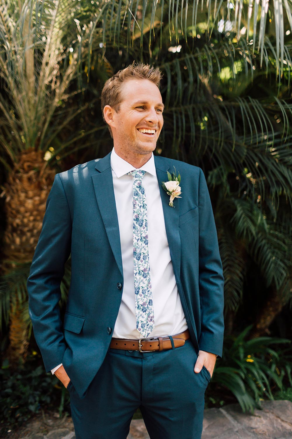 navy groom suit with floral printed tie