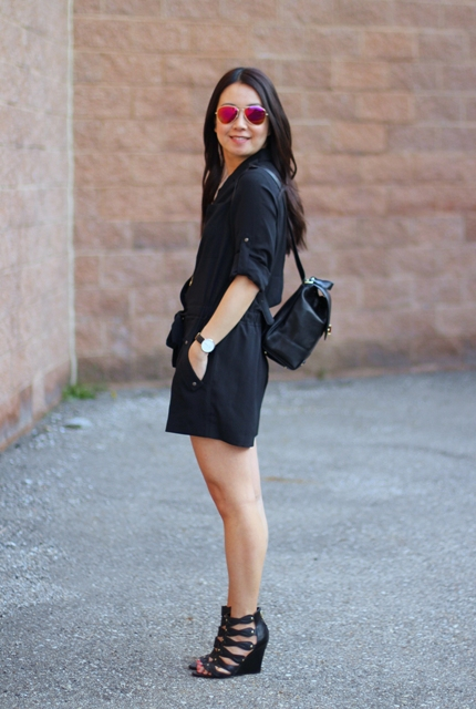 With black romper and black sandals