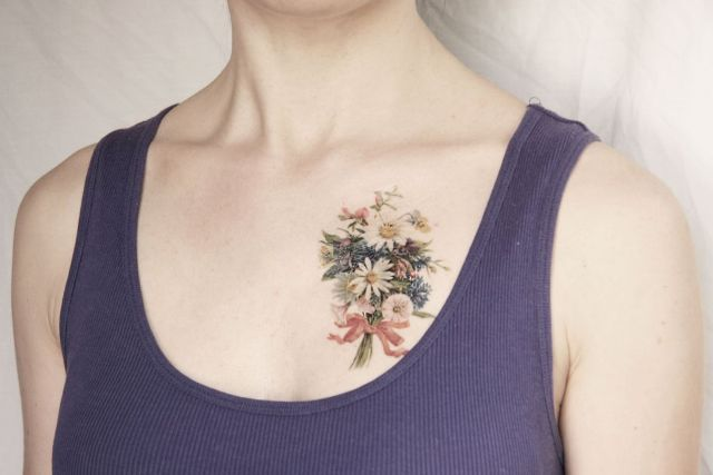 Bouquet of flowers tattoo on the chest