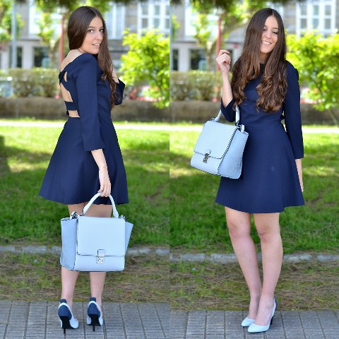 With light blue pumps and light blue bag