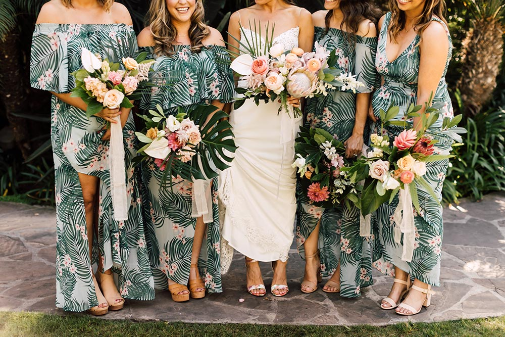 tropical bridesmaid dresses and embroidered wedding dress with tropical bouquet