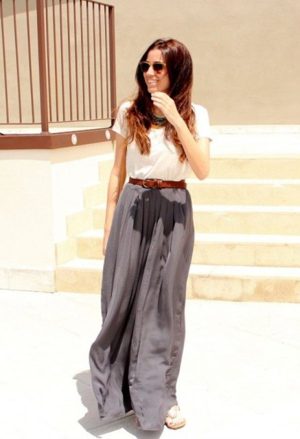 With white t-shirt, brown leather belt and flat sandals