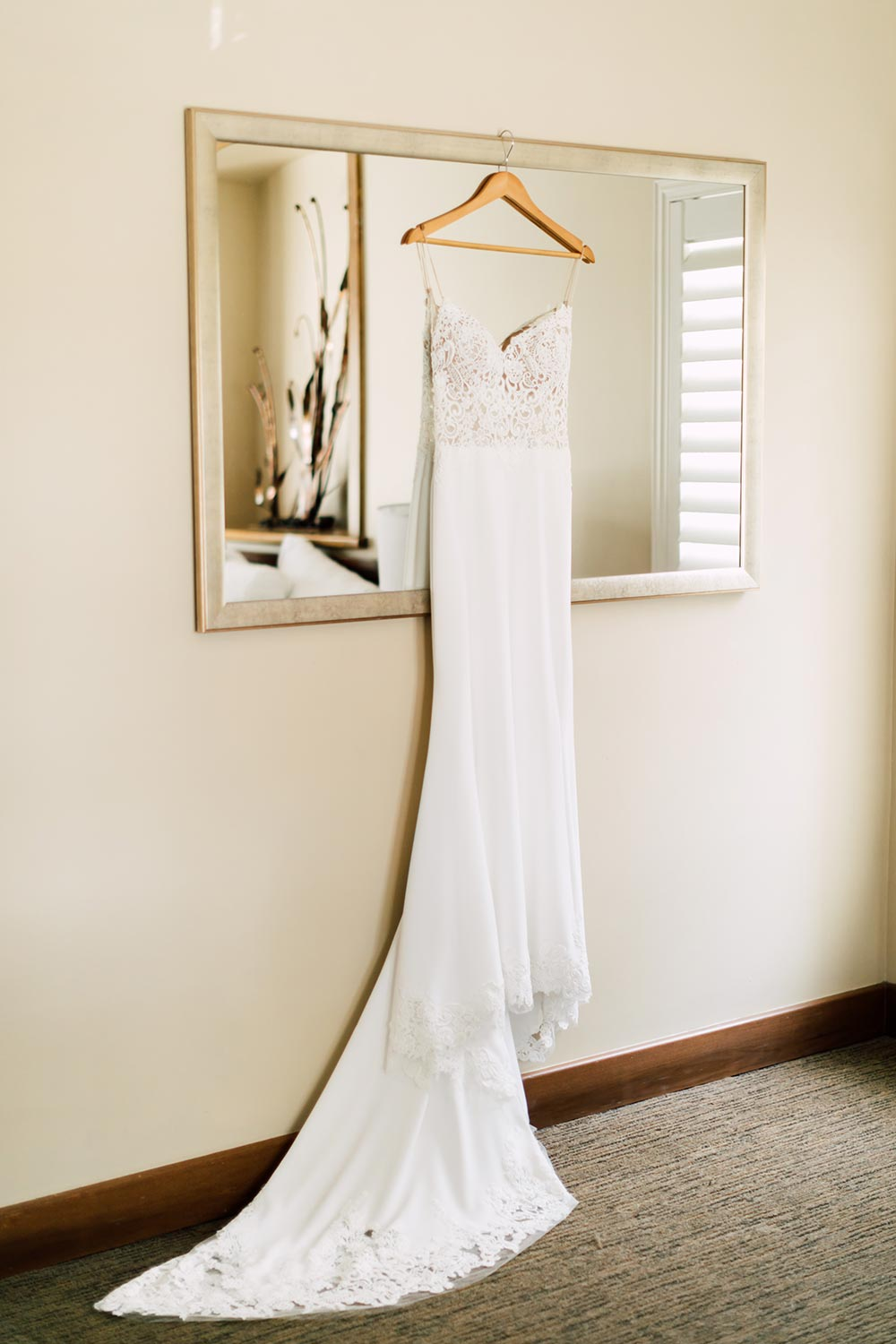 embroidered wedding dress with spaghetti straps and train