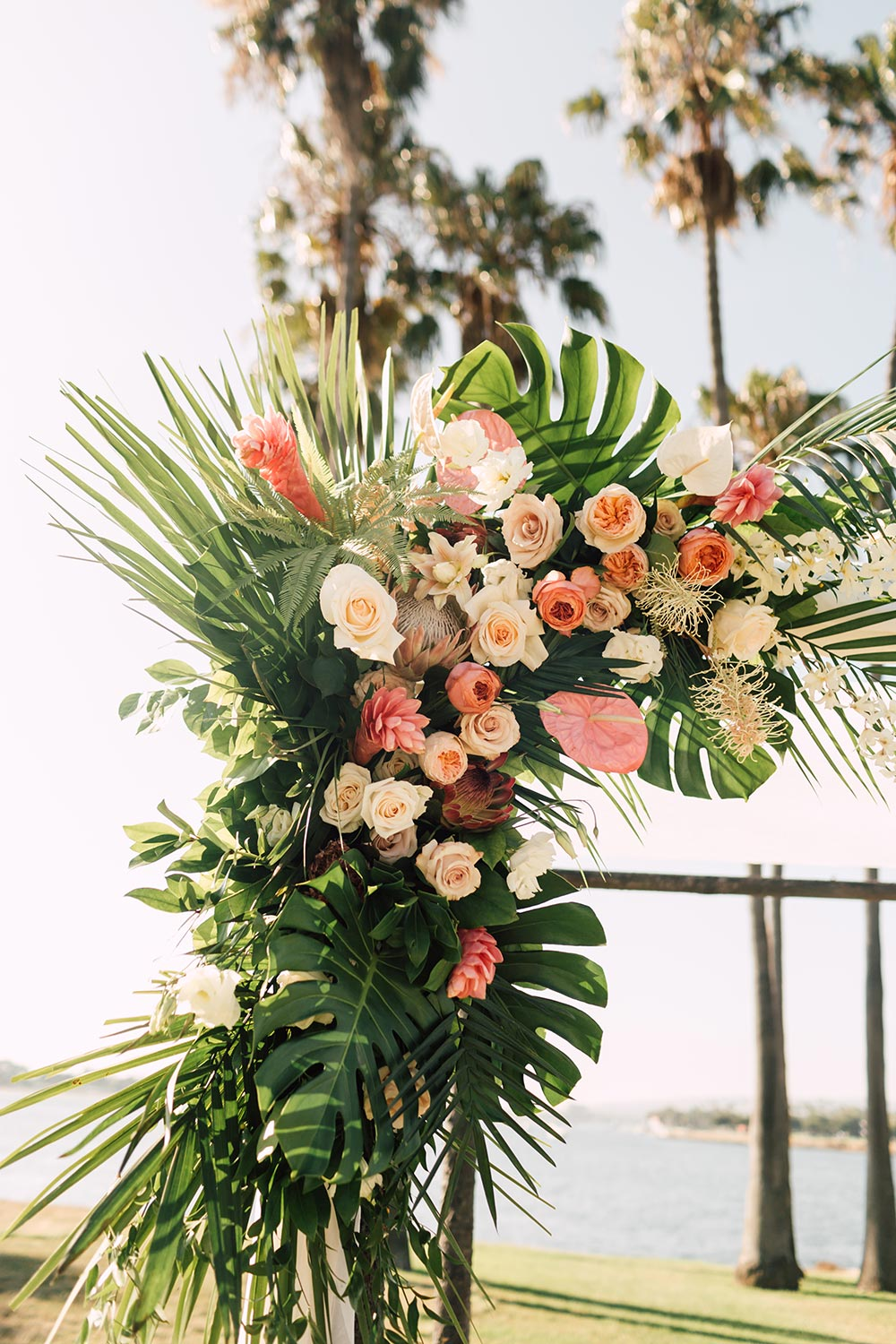 wedding ceremony arch tropical flowers