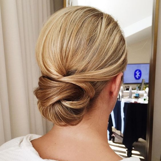 a low twisted chignon looks interesting and non-typical, perfect for an elegant look