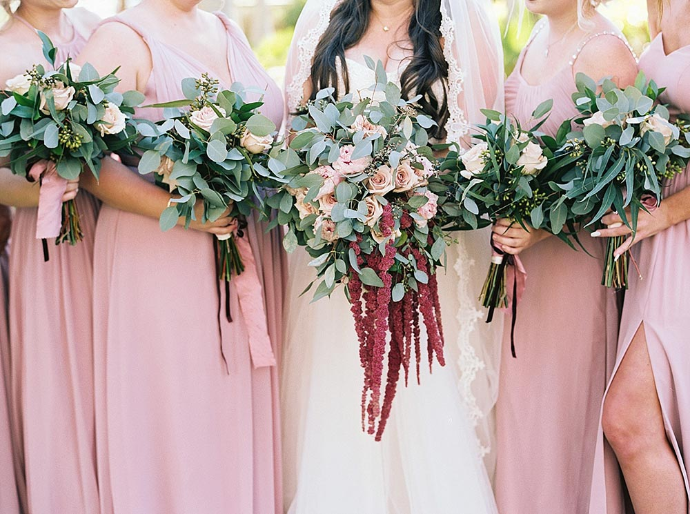 dusty rose bridesmaid dresses with bouquets