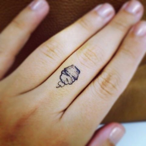 Mini cupcake tattoo on the finger
