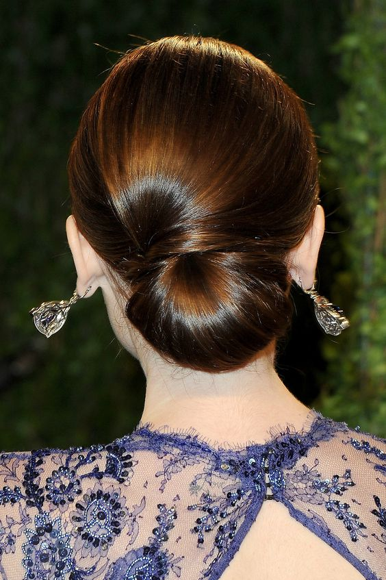 a elegant low chignon with a sideswept section is a very durable option for a picture-perfect look