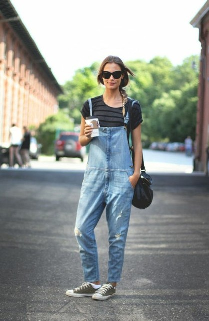 With striped t-shirt, black leather bag and sneakers