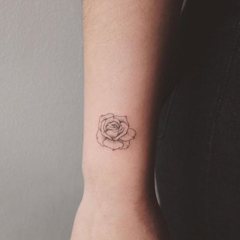 Flower tattoo on the arm