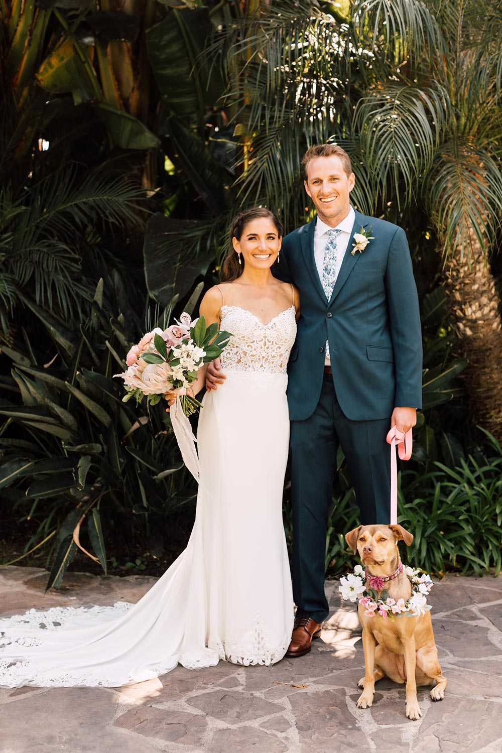 embroidered spaghetti strap wedding dress with navy groom suit and printed floral tie with dog of honor