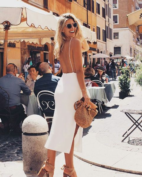 With beige sandals and bag