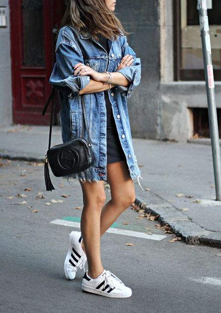 With black mini dress, black leather bag and sneakers