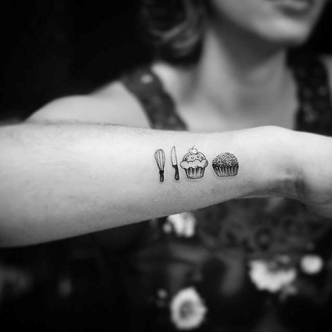 Two cupcake tattoos on the arm