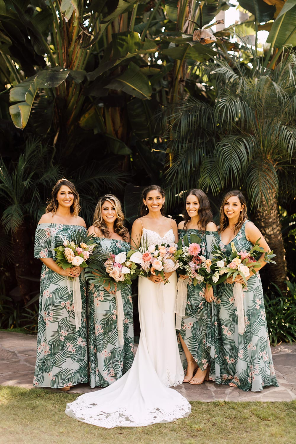 tropical printed bridesmaid dresses and embroidered wedding dress