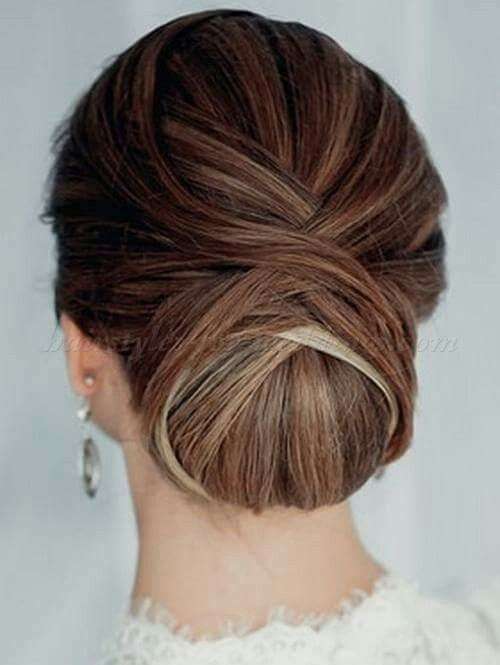 a low twisted very tight chignon guarantees a picture-perfect look for the whole day