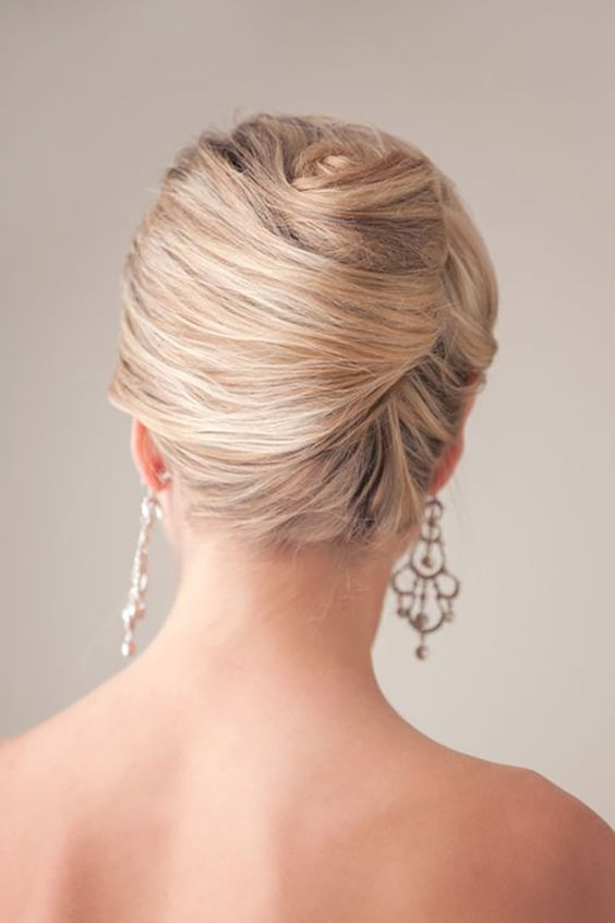 a vintage-inspired twisted chignon hairstyle is a great idea for a picure-perfect look