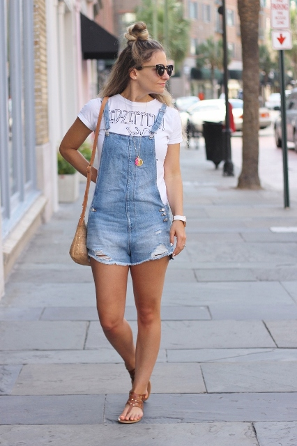 With printed t-shirt, brown flat sandals and small bag