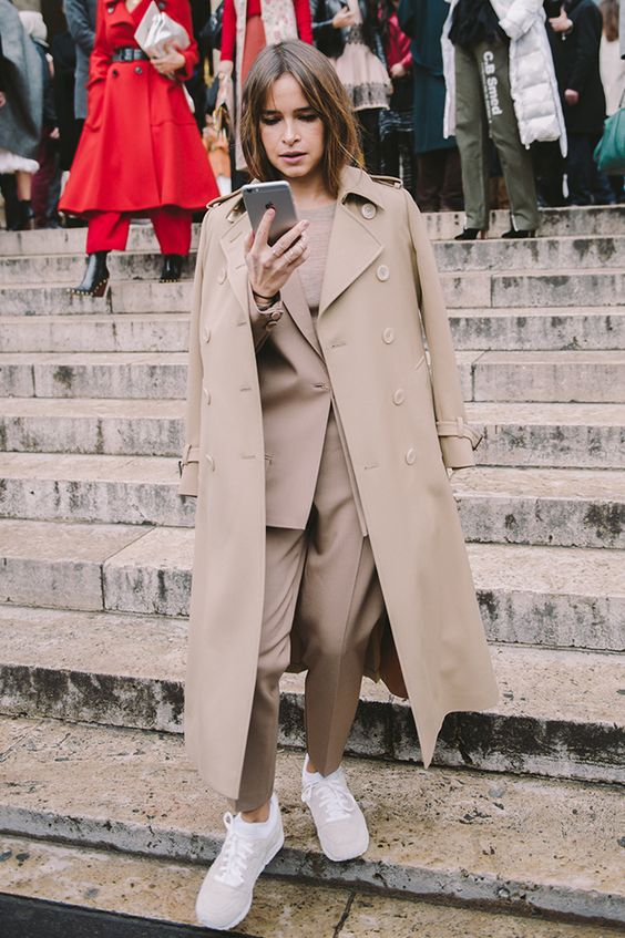 a camel pantsuit, a matching top and trench plus white sneakers for work