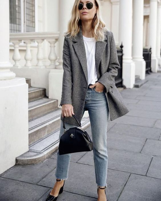 a white tee, a grey oversized blazer, blue jeans with a raw hem and a black bag