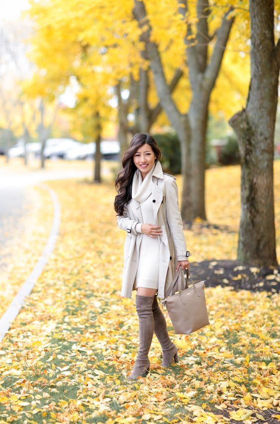 an off-white dress, an off-white trench, a neutral bag and tall suede brown boots