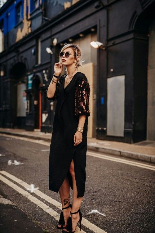 a comfy black midi dress with a side slit, copper sequin sleeves and tassel heels