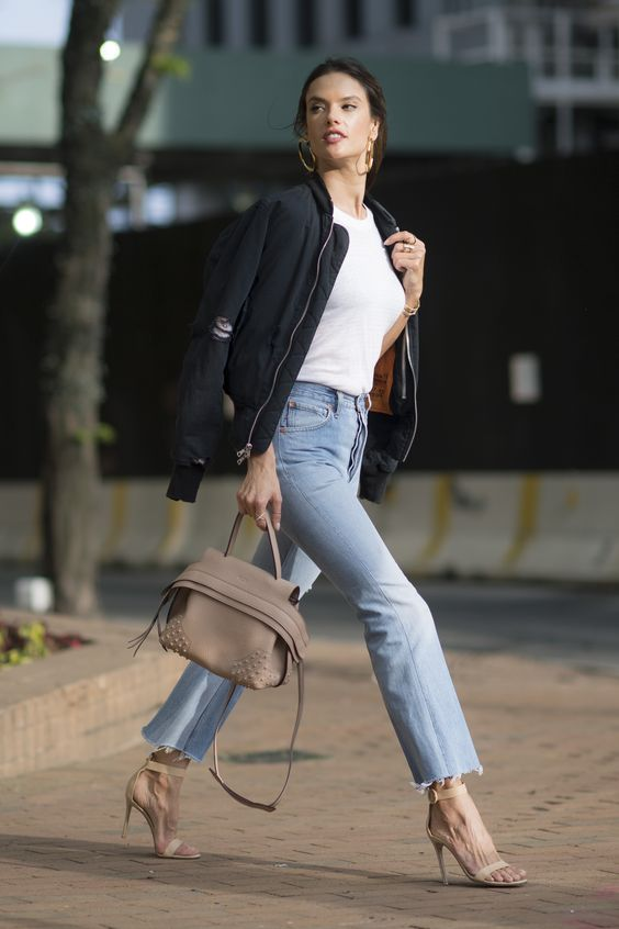 a white tee, blue jeans with a raw hem, nude shoes and a black bomber jacket