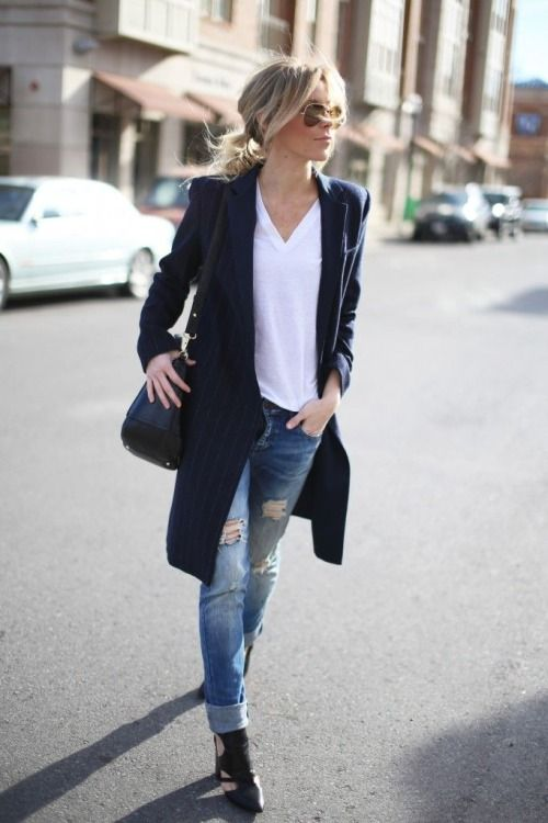 a white tee, a navy striped long cardigan, black boots