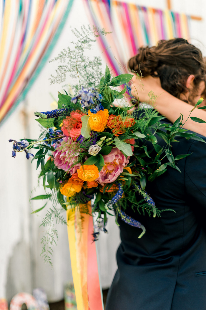 The bridal bouquet was a bold one, with blooms of different shades and colorful ribbons