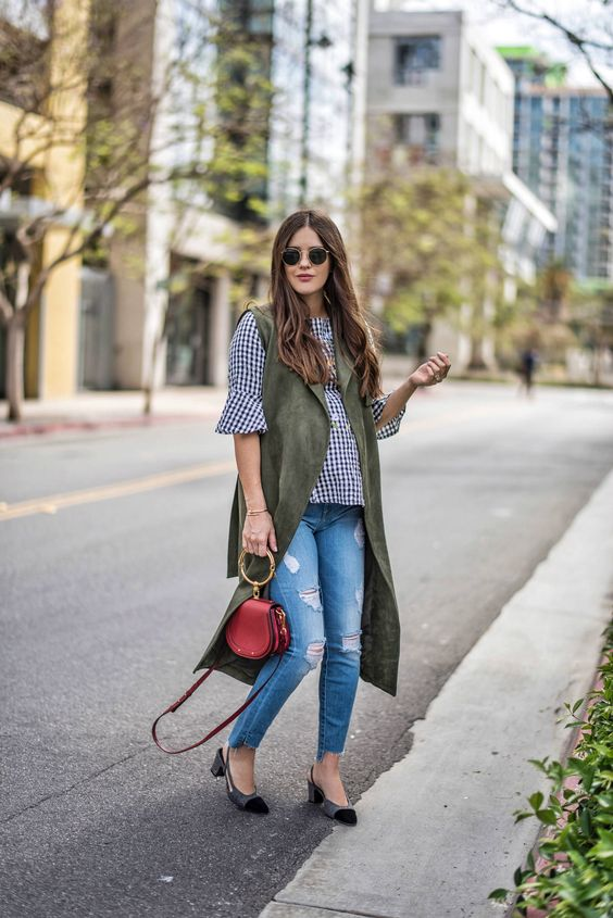 blue ripped skinnies with a raw hem, a gingham shirt, a green long waistcoat, kitten heels and a red bag