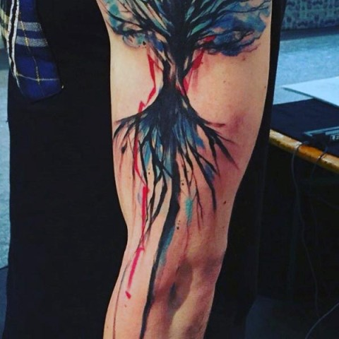 Artistic tattoo on the leg
