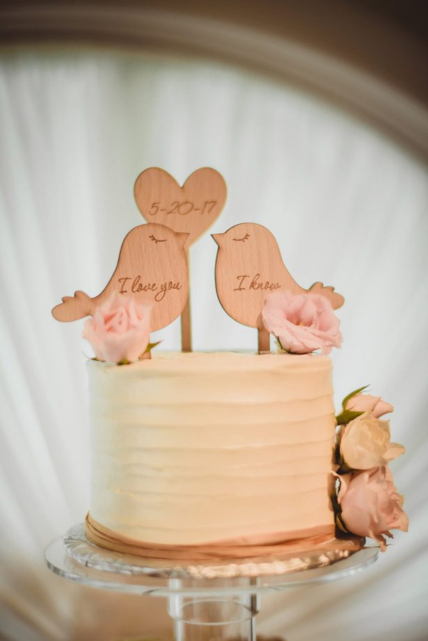 White buttercream wedding cake with bird cake topper- Dani Leigh Photography