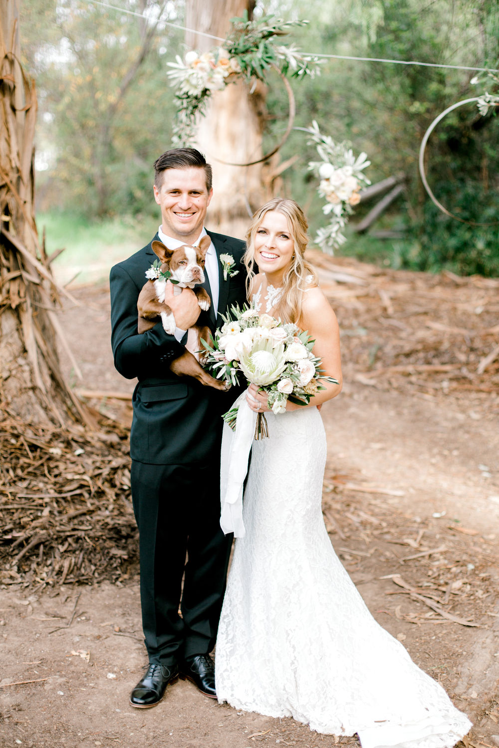 lace illusion back wedding dress and black groom suit with dog of honor