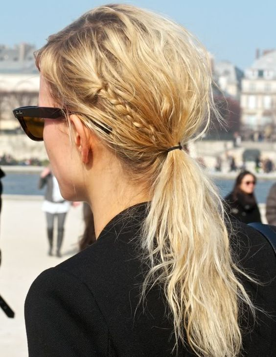 a messy textural low ponytail with little braids is a hairstyle you may easily recreate for casual wear