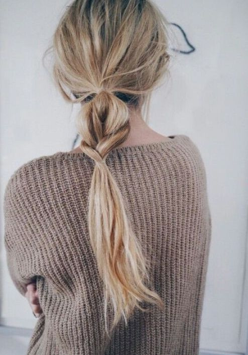 a messy low ponytail with a touch of braid integrated is a cool little hairdo for every day