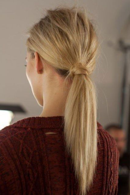 a low ponytail with straightened hair and a messy bump is a chic and modern option