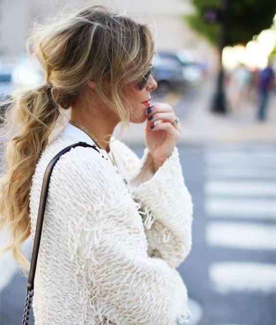a messy and wavy ponytail with wavy bangs and a messy bump is a nice option for every day